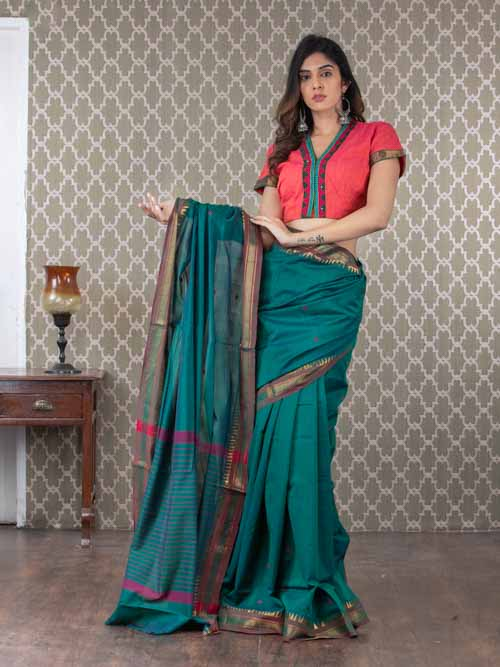 Handwoven cotton saree with zari temple border