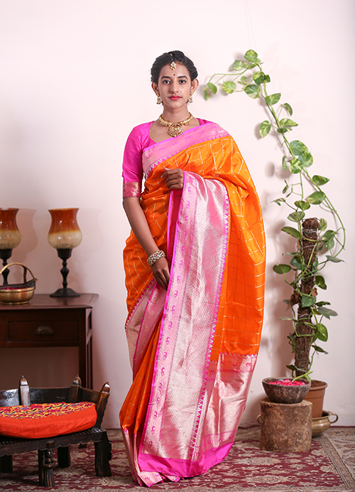 Orange Banarasi saree with Pink Border